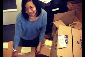 Roadie Brianna packs up goodie boxes to send to shelters